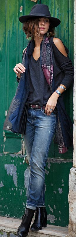 Zoé Alalouch looks edgy yet sophisticated in a patterned scarf and wide fedora. Jeans/Boots/Bag: Zara.