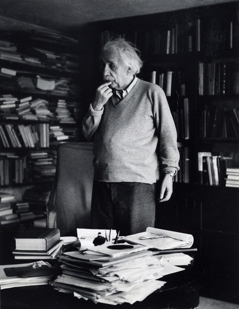 Einstein surrounded by books.