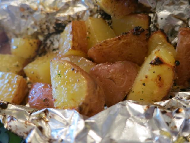 This quick, easy and delicious way to prepare red potatoes on the grill will leave you feeling spoiled!  Side dishes, especially potatoes, can take a while to cook or bake… but not these spuds. Keep this recipe in your back pocket! It's a keeper. Quarter red potatoes and lay a handful on a square of …