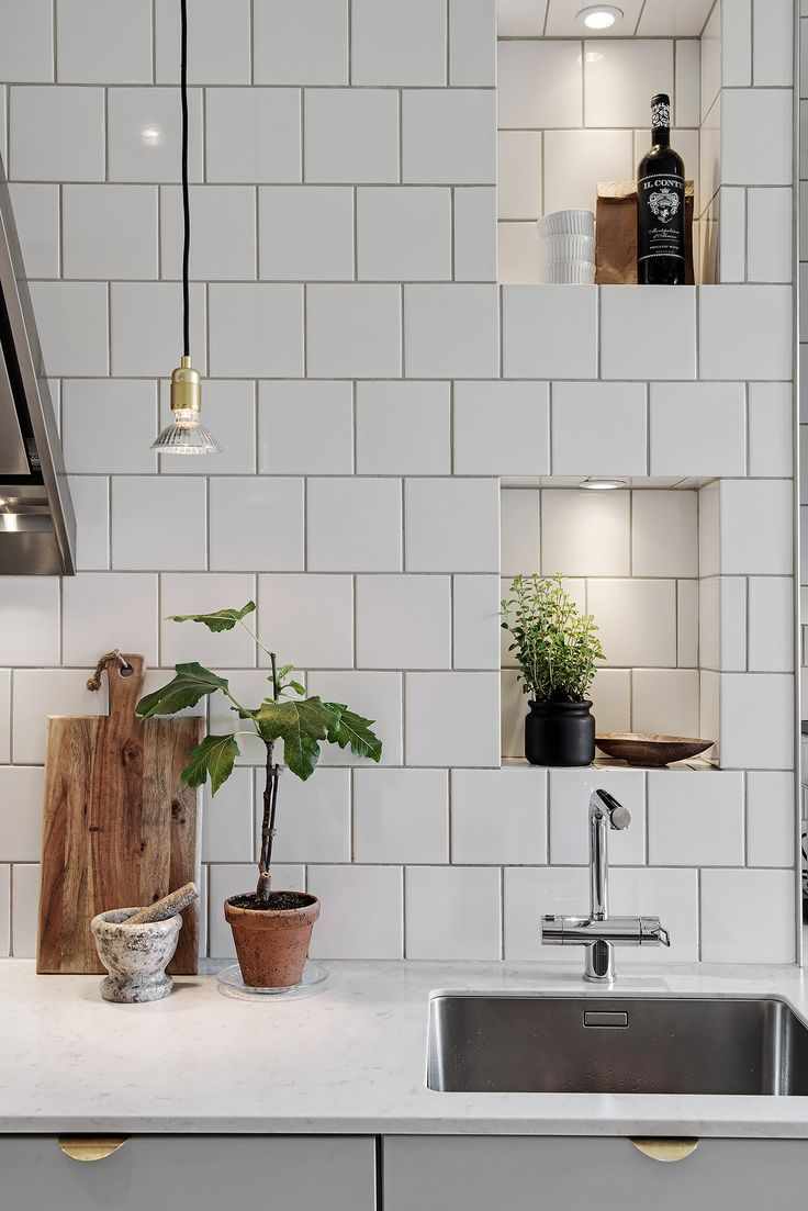 The accent lighting the kitchen if this Göteborg, Sweden apartment gives it a lot of extra personality and look of luxury.