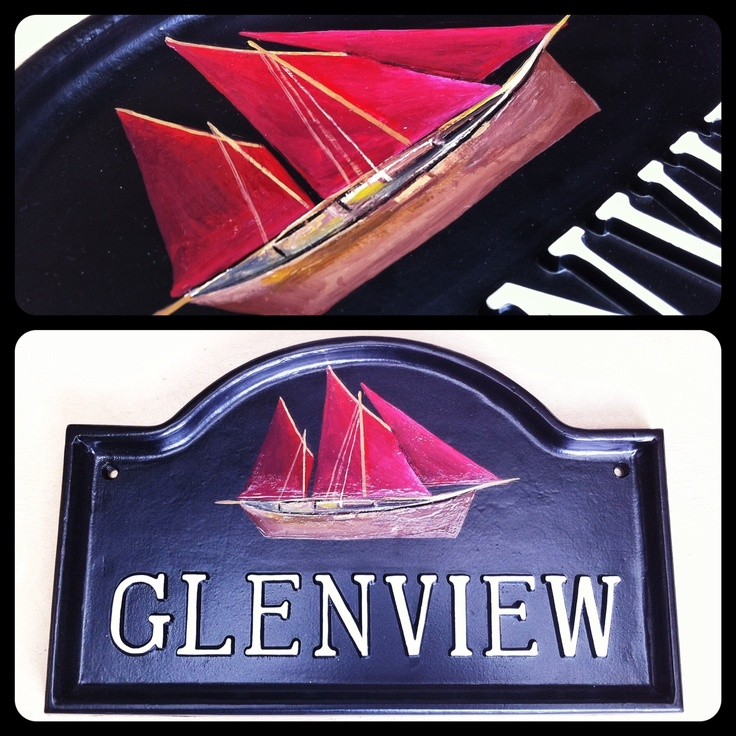 This is a black cast house sign which has been beautifully hand painted with a red sailed Zulu boat. Painted freehand from a photograph, it was a treasure to produce.