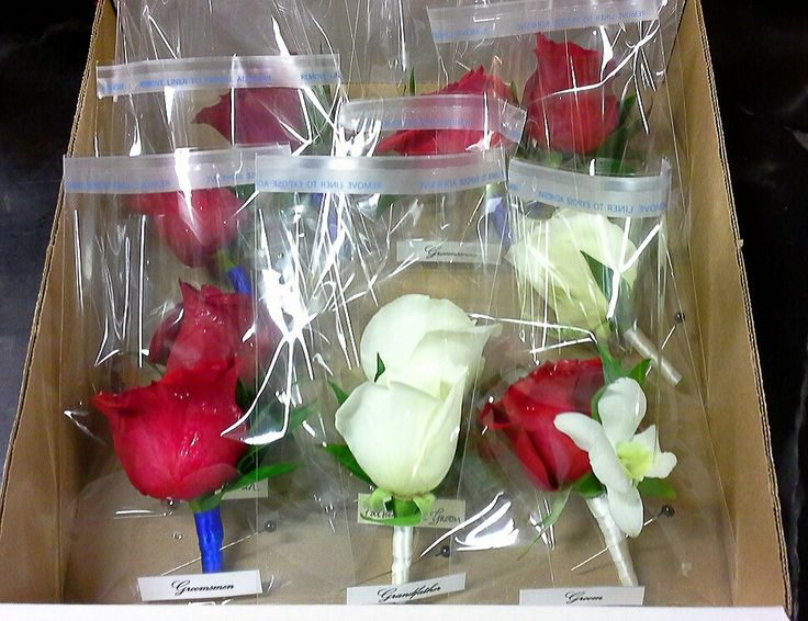 boutonnieres ready for delivery; design by Davis Floral Creations