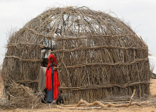 A girl looks out of her makeshift hut on the outskirts in the Dagahaley refugee camp which makes up part of the giant Dadaab refugee settlement on July 19, 2011 in Dadaab, Kenya. The refugee camp at Dadaab, located close to the Kenyan border with Somalia, was originally designed in the early 1990s to accommodate 90,000 people but the UN estimates over 4 times as many reside there. The ongoing civil war in Somalia and the worst drought to affect the Horn of Africa in six decades has resulted…