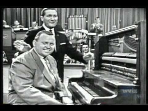 "UPDATE:    I finally fixed the audio for my previous clip. Enjoy!    ""Big Tiny"" Little performes ""The Spaghetti Rag"" and ""Caledonia"" on The Lawrence Welk Show on January 11th, 1958."