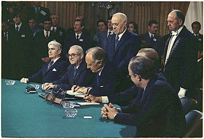 The Paris Peace Accords ending the Vietnam conflict were signed January 27, 1973, and were followed by the withdrawal of the remaining American troops. The terms of the accords called for a complete ceasefire in South Vietnam, allowed North Vietnamese forces to retain the territory they had captured, released US prisoners of war, and called for both sides to find a political solution to the conflict. As an enticement to Thieu, Nixon offered US airpower to enforce the peace terms.