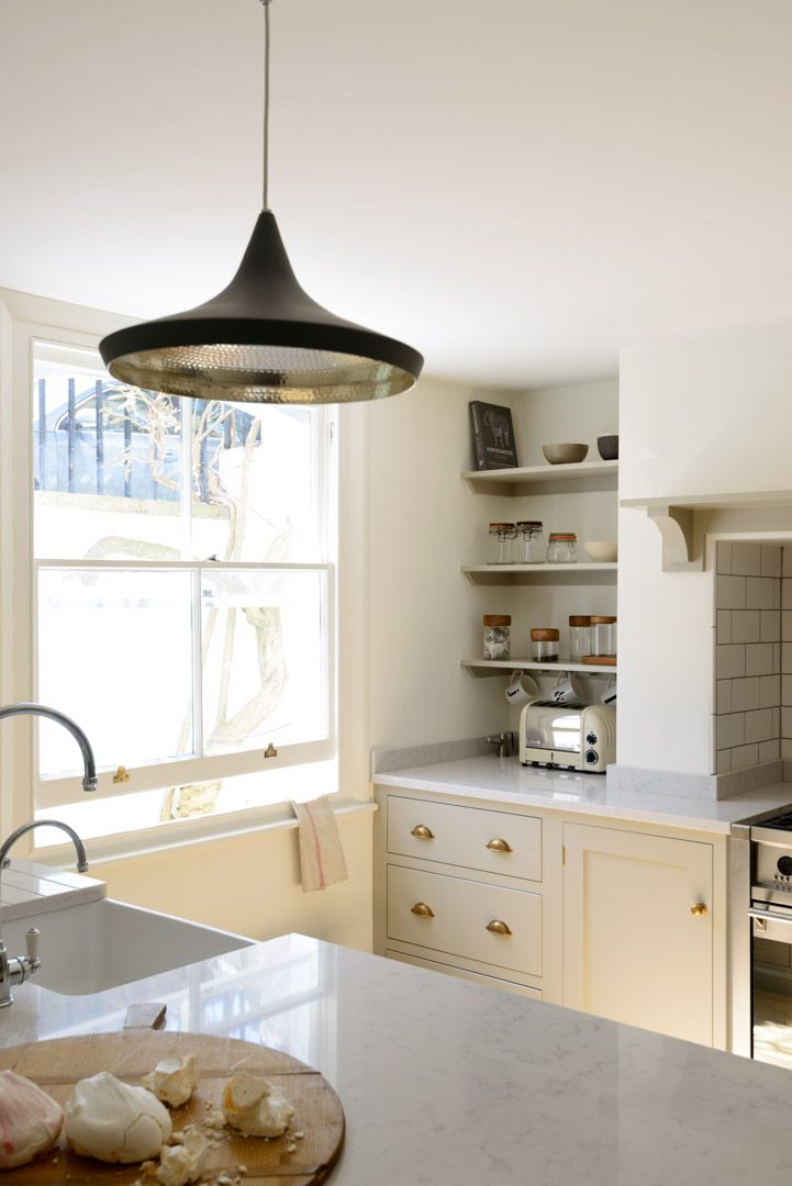 Polished Lagoon Silestone worktop give this Shaker kitchen a lovely luxurious feel