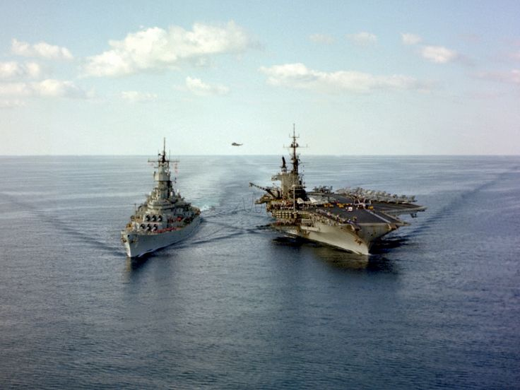 USS Midway (CV-41) conducts an underway replenishment with the battleship USS Iowa (BB-61) on 1st December 1987. Midway and Iowa were in the Persian Gulf area as part of Battle Group Alpha. [28532141]