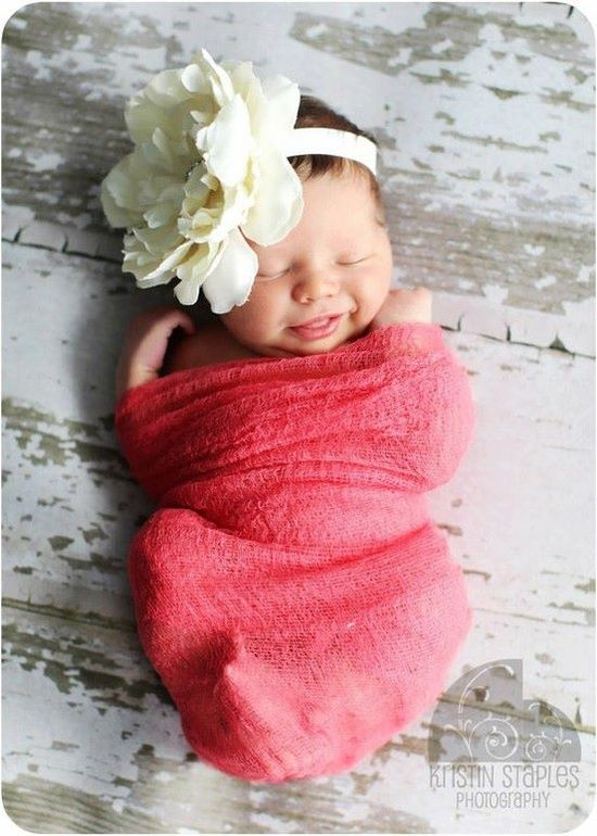 Newborn photography- flat surface, colorful wrap, pretty bow