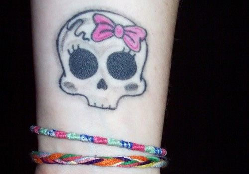 Girly Skull Tattoos. The girlish looking skull tattoos can be coupled with stars, flowers and pink swirly pattern to bring out a pretty feminine tattoo piece.