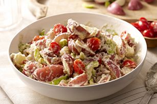 "~ ""PHILADELPHIA Summer Potato Salad""  3  lb. new red potatoes, quartered  1/2  cup water  1/4  cup KRAFT Zesty Italian Dressing  1  tub (10 oz.) PHILADELPHIA Reduced Fat Italian Cheese & Herb Cooking Creme  1-1/2  cups cherry tomatoes, halved  2  stalks celery, sliced  1/4  cup KRAFT Shredded Parmesan Cheese"