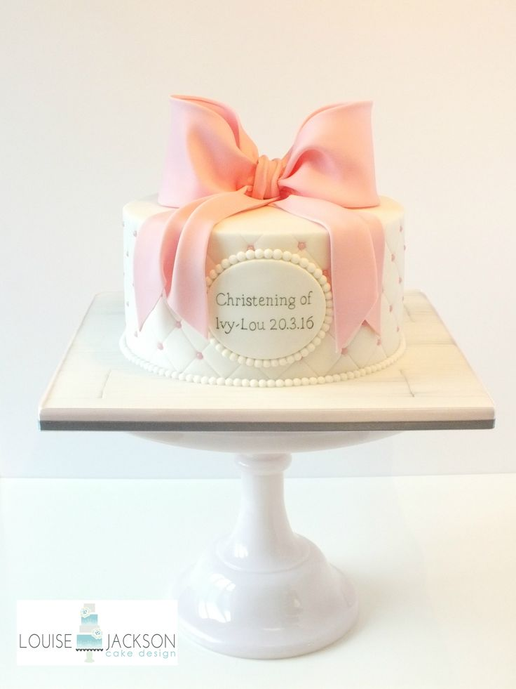 Pretty girls christening cake Quilted & pearls with a large sugar bow and hand painted plaque