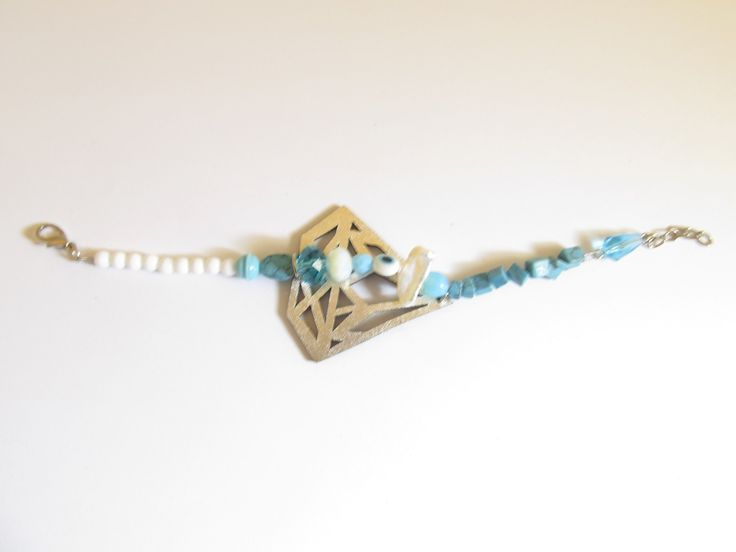 Handmade leather bracelet (1 pc)  Made with turquoise laser cut leather filigree, turquoise stones, white freshwater pearl and glass beads.
