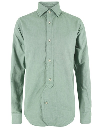 Nigel Cabourn Mainline – BD, mens green Oxford shirt, made using Japanese cotton, with a creased, vintage finish. The shirt features a concealed button down collar, reinforced three quarter length button placket with an extended curved edge, single button cuffs and a curved hem. £300 at Coggles.com