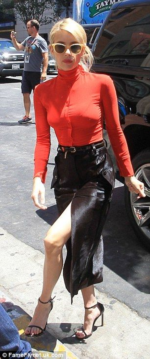 Emma Roberts commanded attention at Comic-Con on Thursday, dressed in a fitted turtleneck ...
