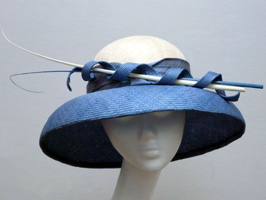 Judy Bentinck Italian Ciel Blue Breton Hat with contrasting cream pinok pok crown trimmed with curved quills.