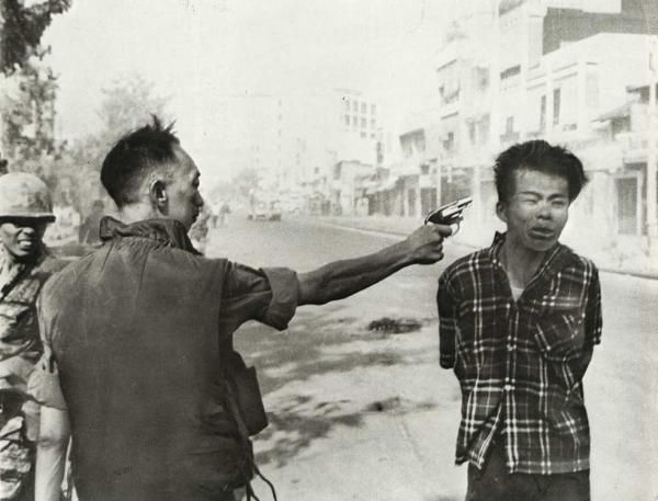 This Pulitzer Prize winning photograph by Eddie Adams is among the most famous war photographs of all time. The man with the gun is General Nguyen Ngoc Loan, the Republic of Vietnam's Chief of National Police, while the man about to die is Nguyen Van Lém, a Vietcong soldier. Story has it that the prisoner was found near a ditch filled with the bodies of 34 police officers and their relatives, including those of the General.