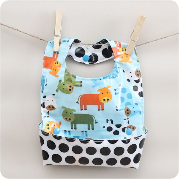 Learn how to make the ultimate baby bib with this free pattern! It has a catch-all pocket and wipes clean