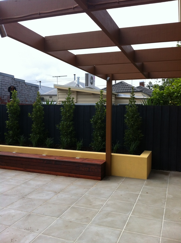 Pergola, paving, bench seat and retaining wall