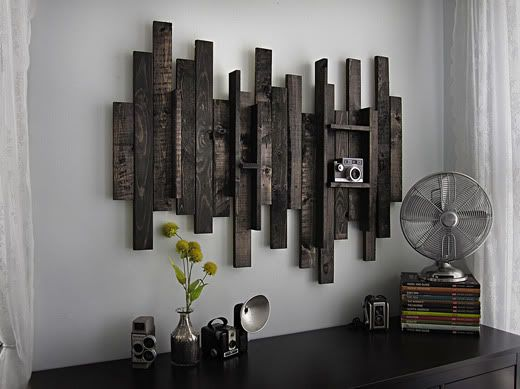 DIY:  Wall art using recycled wood pieces.  Use a supporting board on the back and nail wood slats to the front in uneven pattern. Add a metal wire hanger to the back and VOILA!