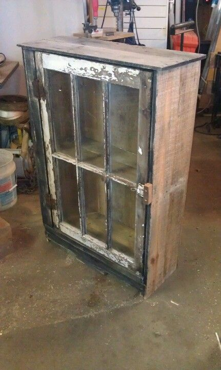 Cute re-purposed window display cabinet. Made with pallet material and old window. Very rustic