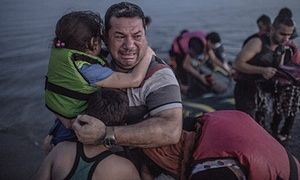Laith Majid cries tears of joy and relief that he and his children have made it to Europe. Daniel Etter