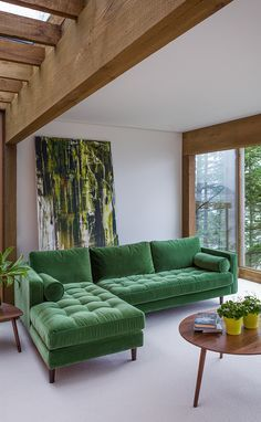 gorgeous green velvet sofa and amazing large painting in contrasting greens. So on trend!