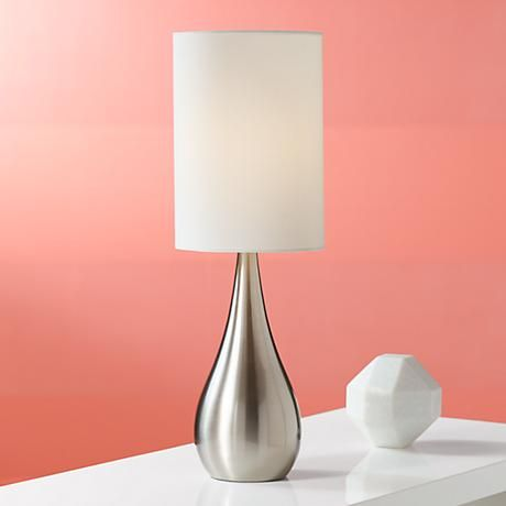 Beautiful in its bold simplicity this contemporary table lamp wears a brushed steel finish and