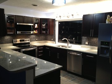 Dark cabinets white granite kashmir white kitchen design for Kitchen designs in kashmir