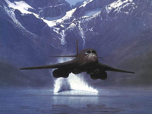 A USAF Rockwell B-1 Lancer supersonic bomber skimming the surface of a lake NOE (Nap Of The Earth)