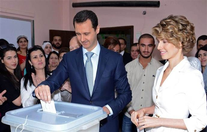 Image: Syrian President Bashar al-Assad and his wife Asma al-Assad casting their votes at a polling station