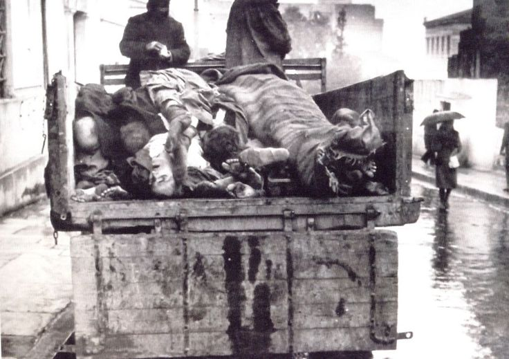 A truck full of corpses passes by Athens University, in the Greek capital, during the Great Famine of 1941-42. The German occupation of Greece caused severe food shortages that affected cities in particular.This image was routine in the streets of Athens as the municipality collected those who had died of hunger each morning.