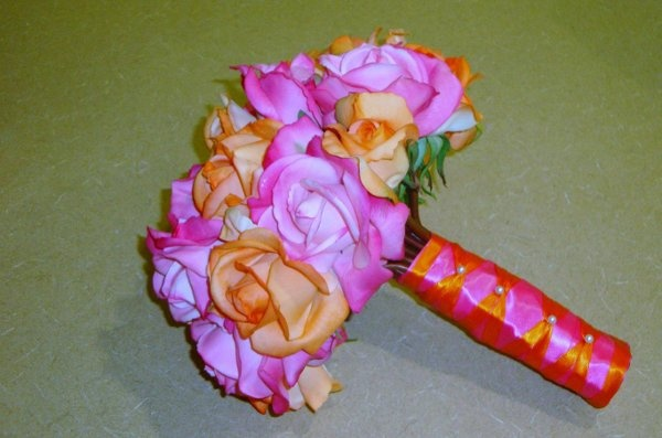 orange and pink.   Roses are the cheapest flower per stem so this is a very affordable bouquet :)