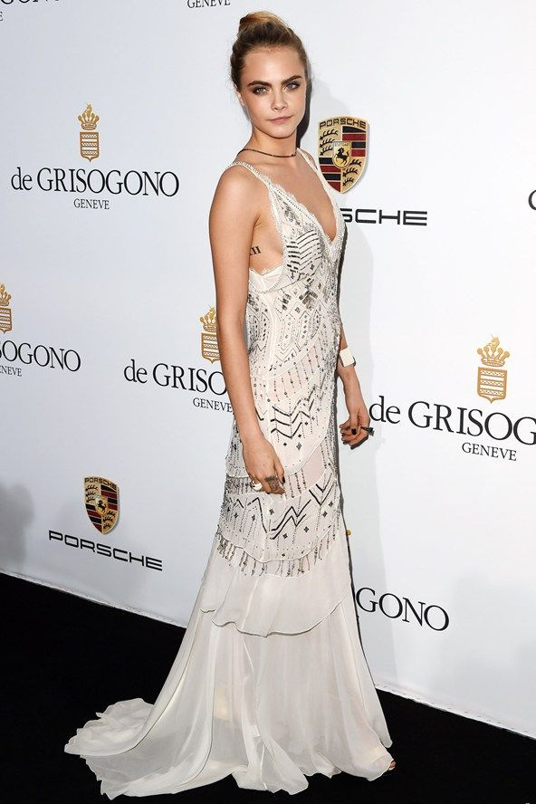Cara Delevingne wore a dress by Roberto Cavalli.