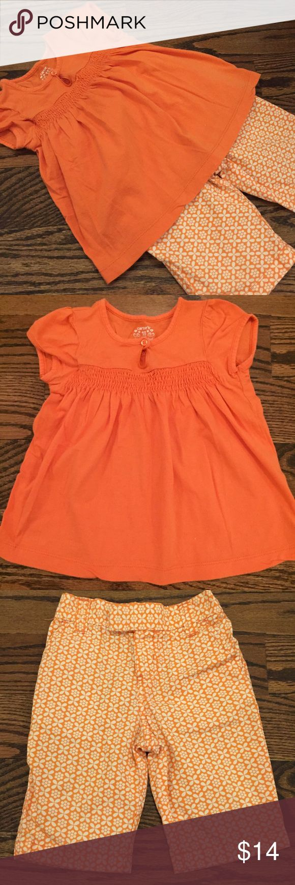 Orange Carter's Capri set She'll be ready for spring in this 🍊 set from Carter's.  The set includes a smocked top and matching patterned capris.  Both are size 18 months.  The pants are in very good used condition.  The hem on the top has a gentle scallop (see pic 5) which I can't remember whether it was purchased like that or if it happened in the wash.  Otherwise in very good used condition! Carter's Matching Sets