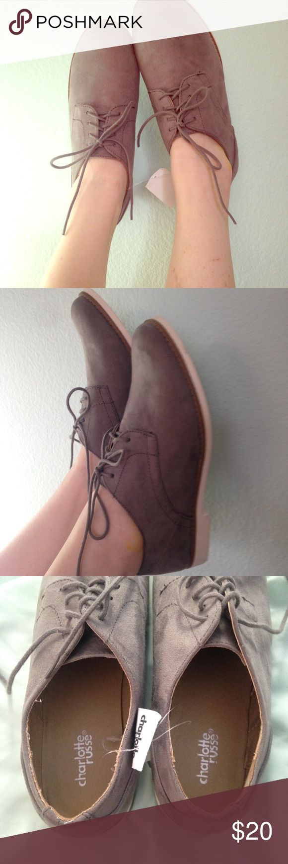Grey suede oxfords Soft and cute Grey suede Oxford lace ups. Never worn with tags. Smart and sweet touch to any outfit! Charlotte Russe Shoes Flats & Loafers