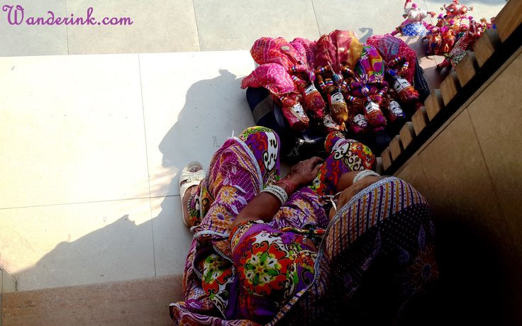 This old lady selling traditional dolls from Rajasthan had come to Delhi to escape the harsher winter months of the desert state.