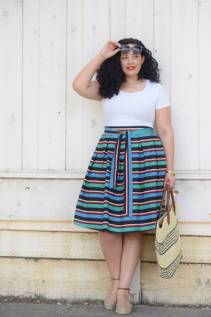Girl With Curves blogger Tanesha Awasthi wears a stripe skirt and espadrille platform sandals.