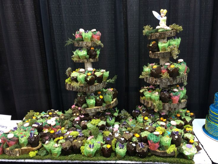 Fairy birthday party cupcake display tinkerbell woodland with rustic moss cupcakes and wood stands  From the Cake Guru