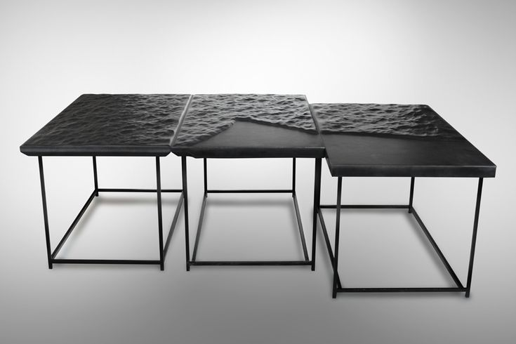 Stark, minimal tables inspired by the sea. The undulating table top is created using leather, and is the collection's defining feature. It's a beautiful effect-- and maybe a little unnerving, too. Mer Noire - Cliff Edition. Designed by Belgian designer Damien Gernay.