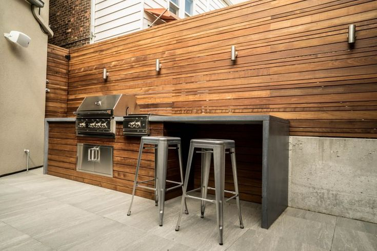 This beautiful grill station is finished off with a waterfall style concrete countertop.