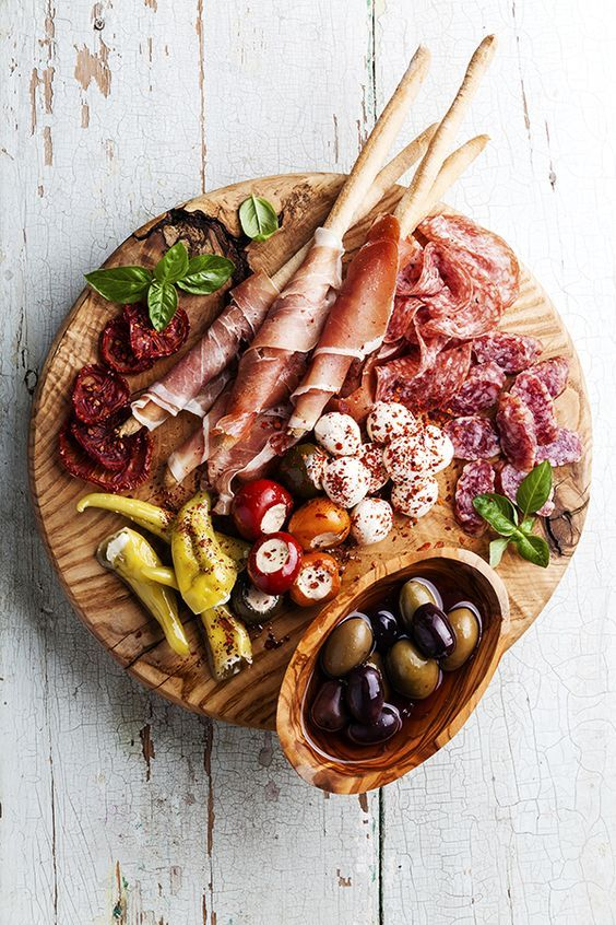 An antipasto platter balances savory and salty flavors; try pairing marinated olives with fresh cheese, dried tomatoes, and plenty of proscuitto.