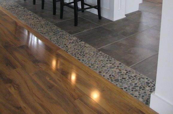 Dark Ocean Pebble Accent Tile Used As Transition From Tile