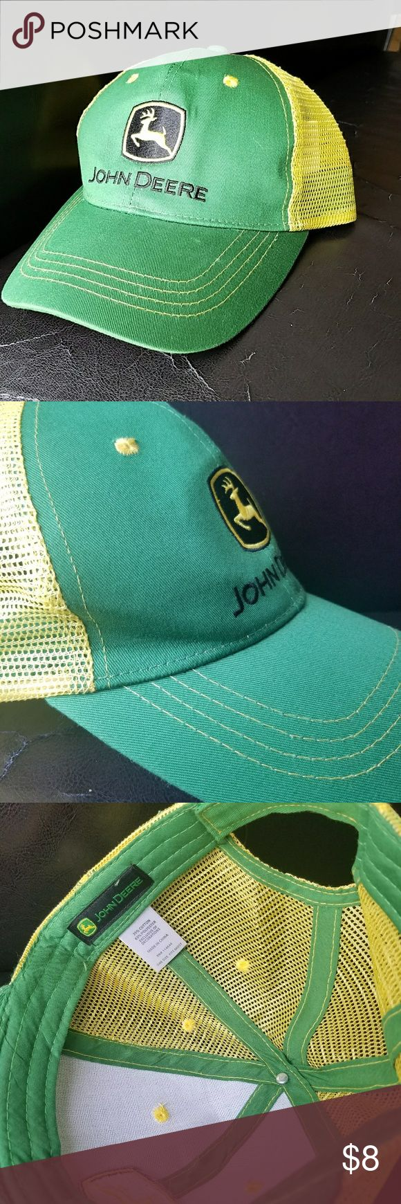 John Deere Hat Good condition . Has a slight dent on the right side (as seen on the photo) bit once on it flats out . John Deere Accessories Hats