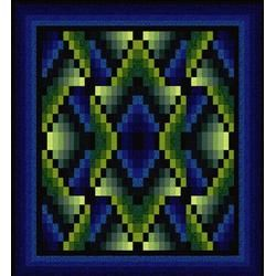 Free Quilt Pattern - Navajo Sunrise is a bargello-style quilt reminiscent of the rug patterns woven by native Americans. The design is created by arranging a repeat of mirrored and non-mirrored versions of a single block. Rotary cutting and strip piecing make the construction of the blocks both quick and easy.