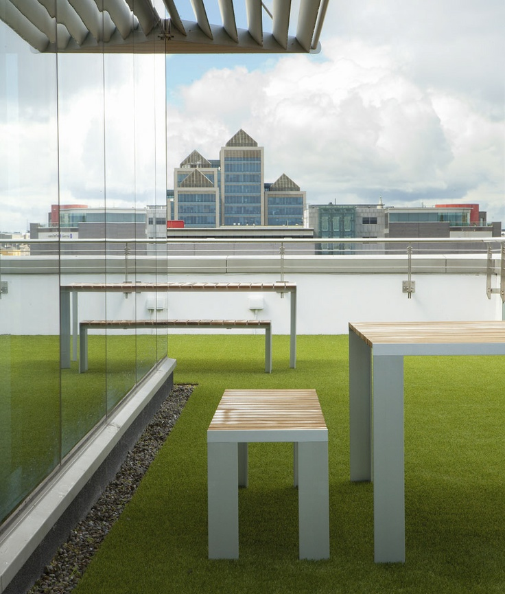 Terrace of Publicis in Dublin with STUA's Deneb table and bench.