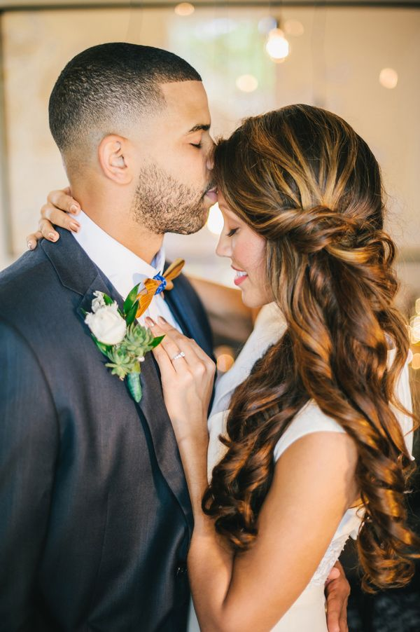 side-swept hair with a twist, photo by Angel He Photography http://ruffledblog.com/tampa-modern-wedding-ideas #weddinghair #bridal #beauty