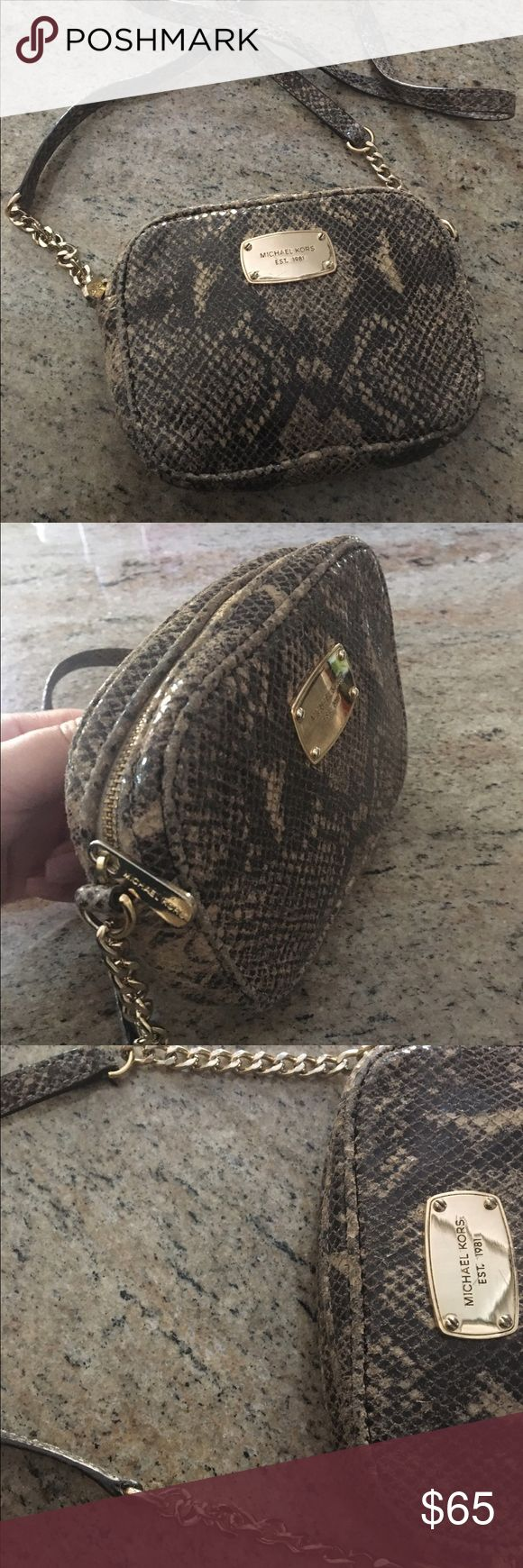 Michael Kors Jetset Crossbody Purse This super-cute purse pairs perfectly with any outfit and is great for any occasion! It has a beautiful snakeskin print and gold accents. This item was well-loved but still in good shape, originally purchased for around $150. Michael Kors Bags Crossbody Bags