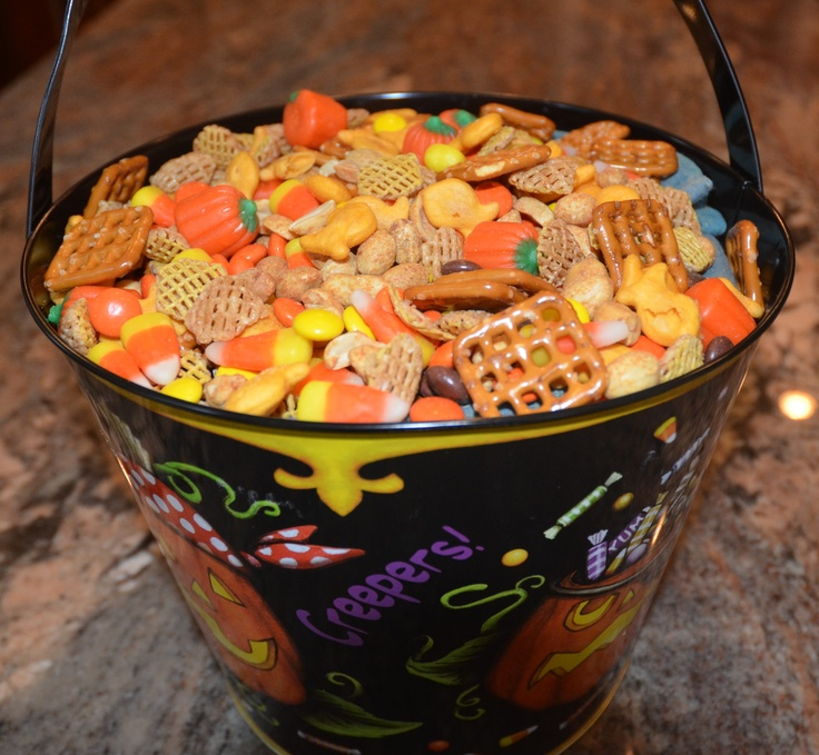 Kim's Halloween snack mix for College Care Package.    Goldfish, Crispix, Peanuts, Pretzels, Reese's Pieces, Candy Corn and Candy Pumpkins