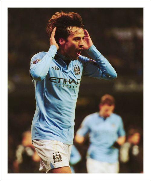 David Silva(x2) celebrates scoring at today's Manchester City victory against Fulham.