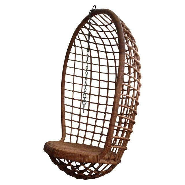 A hanging rattan chair with a caned seat and egg shape. We picture gently swinging on this in living room, curled up with a good book.